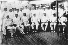 Rear Adm. George Dewey, Commander of the U.S. Asiatic Squadron, with officers of his flagship, USS Olympia (C 6), and his staff on board the Olympia in Manila Bay circa 20 May-1 June 1898.