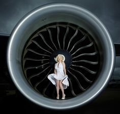 Marilyn Monroe lookalike - Suzie Kennedy - posing with the engine of a brand new aircraft.