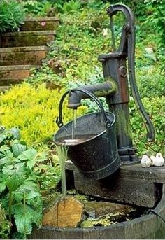 Extraordinary Decorative Garden Fountains IdeasYou can find Water features in the garden and more on our Extraordinary Decorative Gar. Garden Water Pump, Backyard Water Feature, Water Pump Diy, Garden Water Fountains, Diy Fountain, Outdoor Fountains, Garden Ponds, Koi Ponds, Homemade Water Fountains