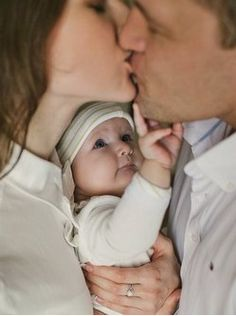 Family lifestyle photography kiss with baby