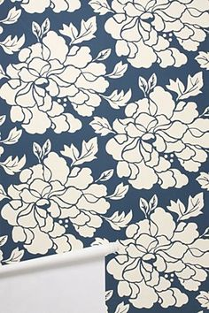 I used to be anti-wallpaper.  But wallpaper like this on an accent wall would be gorgeous.