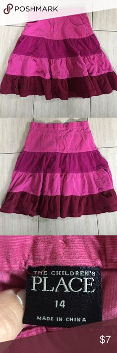 Girls tiered skirt Adorable girls tiered skirt is a soft corduroy. Has the adjustable setting bench inside the waist button and zipper front with two pockets Children's Place Bottoms Skirts