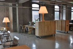 office space that is simple and contemporary in design with wooden furniture by using the wheel