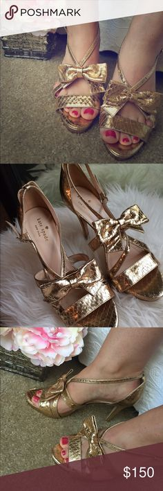 Kate Spade Gemma Python-Print Bow Heels These shoes are SO comfortable and SO chic, they scream Carrie Bradshaw. With a python leather print in metallic gold, these shoes feature strappy uppers and a classy bow with an ankle buckle. The only place you can see noticeable wear is the bottom sole of the shoes (see photo). Other than the bottom soles, they are basically in perfect condition & come with original Kate dust bag that they came in. Size: 7 / Heel Height: 4 in. / Platform Height: 1…