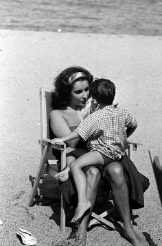 Elizabeth Taylor photographed by Burt Glinn in Sagaro, Spain with her sons while filming Suddenly, Last Summer, 1959.