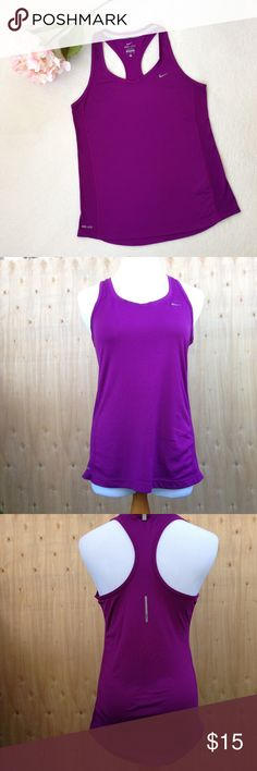 """NIKE Miler Athletic Running Top NIKE Miler athletic running tank has contoured fit for maximum performance. Dri-FIT® fabric wicks moisture to keep you dry and comfortable. Seams sewn flat to enhance durability and prevent skin chafing/irritation. Mesh sides allow sweat to evaporate and cool air to circulate. V-neckline, racerback, reflective silver on back. EUC but logo is slightly worn. Body 100% recycled polyester mesh 100% polyester machine wash. Approx flat meas: 25"""", bust 16"""", waist…"""