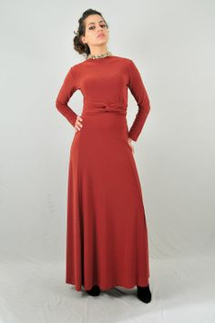 Rust infinity maxi dress. Can be worn several different ways!