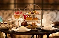 A typical Berlin Afternoon Tea at the Hotel Adlon Kempinski with nibbles and champagne.