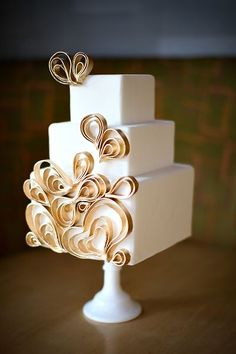 Mod white and gold square wedding cake | Pair it with perfect wedding hair and makeup: http://vensette.com/bridal_inquiries