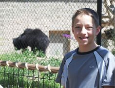 TJ Becker by the bear exhibit at the Tauphus Park Zoo.  July 2013  TJ is growing up quickly