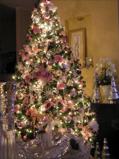 Pink & crystal Christmas tree with pink poinsettias, pink roses, & silver ornaments ~ Feb 8, 2008 from http://judith-sweetdesigns.blogspot.com/2008/02/sweet-pink-christmas-tree.html?m=1