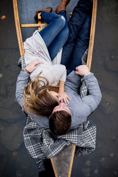 Fall engagement photography with couple cuddling in a canoe on the lake in Saratoga Springs NY | Tracey Buyce Engagement Photography