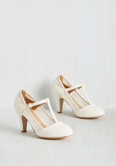 Romance on Air Heel in Ivory. Buckling these ivory heels for a date night with your sweetheart, you send a sweet aura into the atmosphere. #cream #modcloth