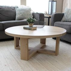"""General Round Solid All Wood White Oak Coffee Table, Modern Crossed Legs Custom Requests - Contact Us or info@jwatlaswoodco.com Call or text directly - 970-449-3322 Production Time of14-21 Days Dimensions • CUSTOM SIZES AVAILABLE UPON REQUEST• Dimensions: 36"""" x 36"""" Round x 17""""H• Matte poly finish Description This bea"""