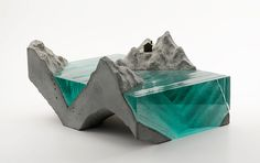This guy makes sculptures by putting layer upon layer of hand-cut glass sheets and then hand-carves them into waves and other water-like forms