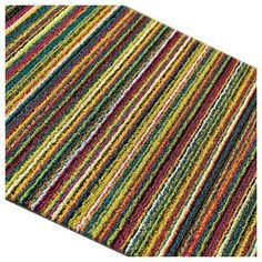 Chilewich Shag Skinny Stripe Big Mat - Multi Color by Chilewich. $160.00. Design: Sandy Chilewich. Size: 3' x 5'. Made in USA. Material: vinyl. Indoor / Outdoor. Chilewich's ultra-durable PlynylTM flooring is down for the count. Each floormat is made of woven vinyl and backed with post-industrial material. Chilewich floormats are at once practical, versatile, low-maintenance and elegant. Ideal for kitchens, bathrooms, outdoor terraces and entryways. Good in all weather, quick ...