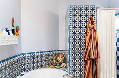 This modern Moroccan-inspired bathroom combines patterned tile with periwinkle walls. Color: Lavender Cloud. Photo by Dabito for #thenewbohobook. Décor & #colorinspiration from @justinablakeney via MyColortopia.com