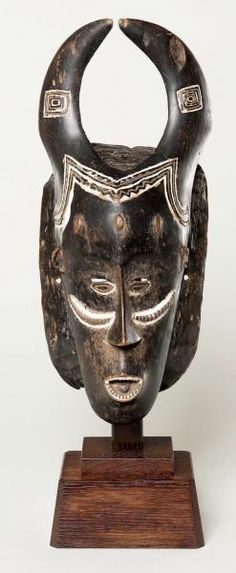 Face Mask  late 19th–early 20th century Guro peoples Côte d'Ivoire Wood, pigment, plant fiber 12 3/8 x 5 1/4 x 3 3/8 in. (31.4 x 13.3 x 8.6 cm)
