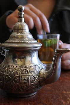 My Silver Moroccan teapot, my Moroccan tea-glasses, and enjoying a languid summer's evening sipping my sweetened Mint Tea . dreaming of Morocco . Coffee Time, Tea Time, Tea Culture, Peppermint Tea, Tea Art, Moroccan Style, My Tea, Tea Ceremony, High Tea