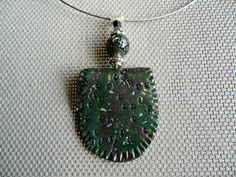 A medley of green pendants by ColoursofPaysCathare on Etsy