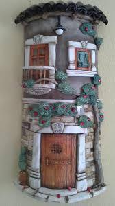 Resultado de imagen para tejas decoradas en relieve