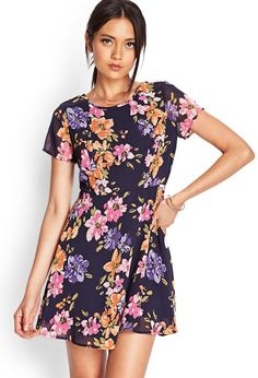 The artistic fashionista's dream! This skater dress features a painted floral print and buttoned ...