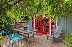 Apartment Therapy Home Tour | shaded deck with red exterior doors