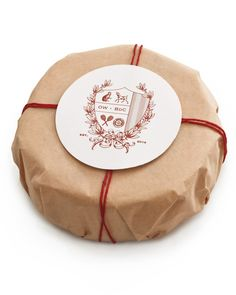 Send guests off with wrapped Camembert adorned with your custom crest. Chicago graphic designer Sarah Drake will create an image based on your shared interests (the example here is inspired by a couple who met through their pets and enjoy playing tennis and collecting vintage coins). Fill out her short questionnaire, and she'll send you a digital file that you can apply to virtually anything.
