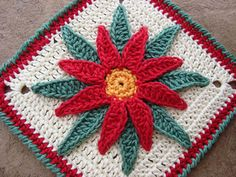 http://www.ravelry.com/patterns/library/granny-poinsettia-flor-de-nochebuena