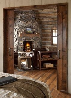 Opposite the bedroom...the library/sitting area at the top of the stairs. Love the natural stone fireplace. Cozy spot