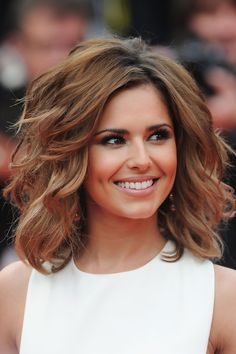 Cheryl Cole Lookbook: Cheryl Cole wearing Short Wavy Cut (5 of 125). The beautiful brunette wore a voluminous, waved hairstyle with honey-hued highlights.