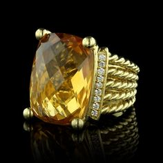 We love this David Yurman 18K yellow gold citrine and diamond ring