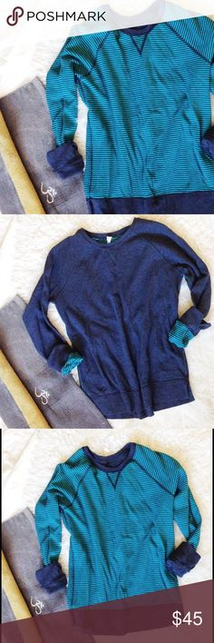 Lululemon Reversible Sweatshirt Soft and comfy cotton/modal blend. Beautiful navy like solid blue on one side. Dark and turquoise stripes on the other. Split hem and split sleeves make cufing or rolling easy and can show the reverse side color.  Longer length makes it flattering over yoga pants. 💕 Excellent used condition. Tag hasn't even come off and we all know how easily those lulu tags are meant to come off. I'm a 6/8 and this doesn't fit super baggy. I preferred it instead of the more…