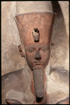 Sandstone Osiride statue of Amenhotep I with red and black painted detail. Early 18 dynasty. British Museum.