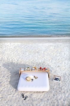 This would be perfection right now. Sand, ocean, comfy spot for sun bathing and reading- amazing and relaxing