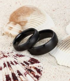 Simple but classic ! This set of domed black ceramic rings is brushed on the surface but the beveled edges are polished to have a contrasting look. Great choice as his and her matching weddding band set.