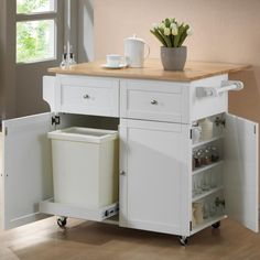 Kitchen, Wooden Countertop With Cute Potted Flower Decor Also Awesome White Portable Kitchen Island With Smart Storage Organization: Small Portable Kitchen Island Designs with Wheels