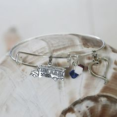 Expandable Alex and Ani type bracelet with School Bus, Heart and Red, white and Blue Swarovski Crystals by SeaglassI on Etsy https://www.etsy.com/listing/195283189/expandable-alex-and-ani-type-bracelet