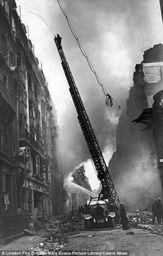 An poster sized print, approx mm) (other products available) - Blitz in London -- turntable ladder in operation, with firefighter and hose. - Image supplied by London Fire Brigade - poster sized print mm) made in the UK London Bombings, The Blitz, Rare Images, War Photography, British History, Uk History, London History, Fire Trucks, Turntable