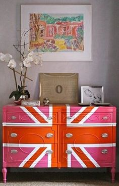this is what life is all about. pink and orange painted dresser