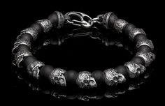 This bracelet is its own class – despite all the beaded bracelets and skulls out there, the Shaman stands apart. Skull beads are sculpted in sterling silver, beautifully rendered based on the powerful 'sugar skull' tradition from Mexico. Clasp is also crafted from sterling silver, and the alternate beads are frosted black onyx. A little bit of rock n roll, a little bit of a bike on the open road, a tribute to a great tradition and a distinct spin on a familiar form. Find your own road wit...