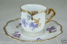 ANTIQUE LIMOGES DEMITASSE CUP SAUCER GOLD,BLUE LAVENDER OR FORGET ME NOT FLOWER