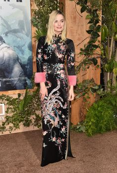 """To the premiere of """"The Legend of Tarzan"""" Margot Robbie wore a Gucci Fall Winter 2016 satin kimono fully embroidered gown with contrast plush cuffs by Alessandro Michele."""