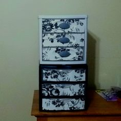My copycat version of make up drawers! I took two steralite storage containers and decorated the drawer fronts using contact paper.  Thanks vanillajoy.com whom I got this idea from!