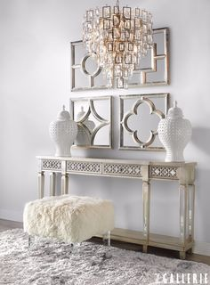Four mirrors above chest in entry way