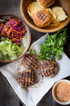 A Delicious recipe for Thai Turkey Burgers- with lemongrass, ginger & basil, topped w/ a Crunchy Asian Slaw and Spicy Aioli. Light, healthy, FLAVORFUL! Easy to make. | www.feastingathom... #thaiturkeyburger #thaiburger #turkeyburger