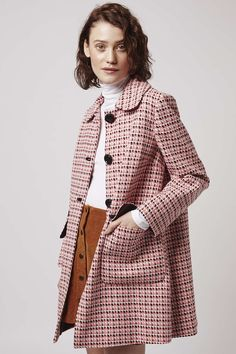 Our Geo weave coat with round collar and contrast buttons will ensure you nail 60s cool. #Topshop