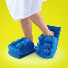 Stepping on a LEGO brick wonât hurt ifyouâre wearing these slippers - Are you a LEGO fan? I bet you dont have a pair of these snazzy LEGO slippers under your bed. Only the true LEGO fanatic will add a pair of these LEGO Brick slippers from