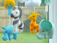 Welcome to FlossyTotsWelcome to FlossyTots  This beautiful Animal mobile is MADE TO ORDER  This colourful mobile consists of a Hippo, Elephant, Giraffe and Zebra in premium wool blend felt There is a cloud or tree above each animal and the hoop is decorated with grey felt.  CUSTOMISE If you prefer you can choose your own colours of felt to match your nursery or bedding, just convo me to discuss!  APPROXIMATE DIMENSIONS:-  Wooden Hoop 10 Elephant 4.5 x 4.5 Hippo 4.5 x 4.5 Giraffe 5 x 3 Large…