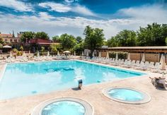Camping Village Roma Roma Just 15 minutes' drive from the Vatican, Camping Village Roma is the closest camp site to Rome's historic centre. Features include a seasonal outdoor pool, hot tub, and poolside bar. The Village Roma offers chalets and air-conditioned bungalows.